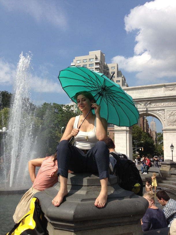 A beautiful green parasol in Washington Park on a sunny day.