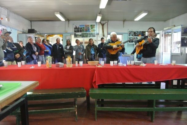 UST Workers spending time together, playing music for us, after lunch.