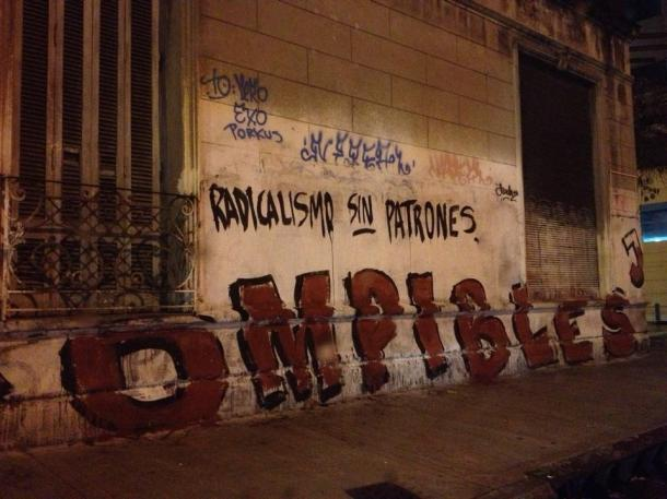 "The graffiti reads, ""Radicalism without bosses."""